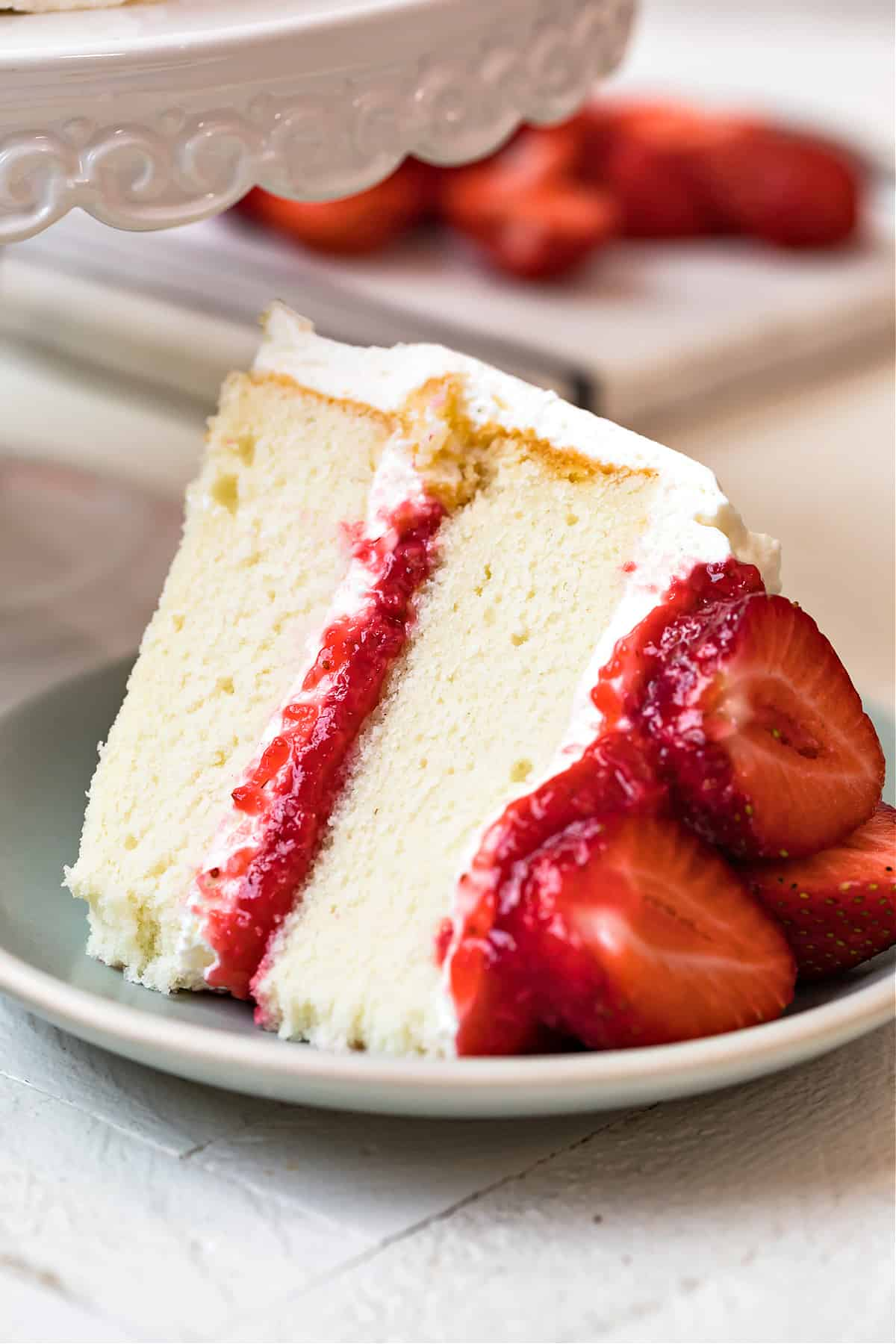 White Layer Cake with Whipped Cream Frosting and Strawberry Filling